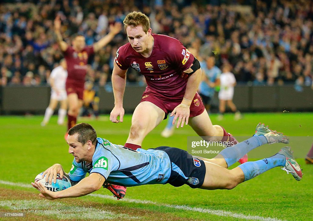 Mitchell Pearce of the Blues scores a try which was later disallowed by the video referee during game two of the State of Origin series between the New South Wales Blues and the Queensland Maroons at the Melbourne Cricket Ground on June 17, 2015 in Melbourne, Australia.
