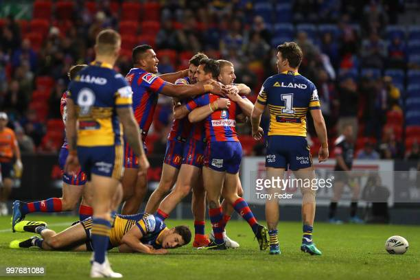 Mitchell Pearce of the Knights celebrates a try with team mates during the round 18 NRL match between the Newcastle Knights and the Parramatta Eels...
