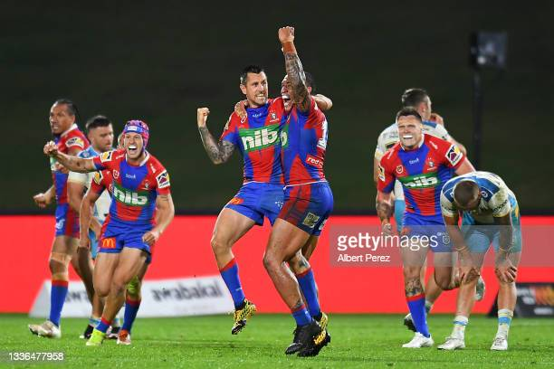 Mitchell Pearce of the Knights celebrates with Tyson Frizell after kicking a penalty goal to win the match during the round 24 NRL match between the...