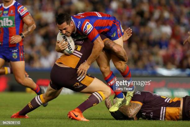 Mitchell Pearce of the Knights is tackled during the round five NRL match between the Newcastle Knights and the Brisbane Broncos at McDonald Jones...