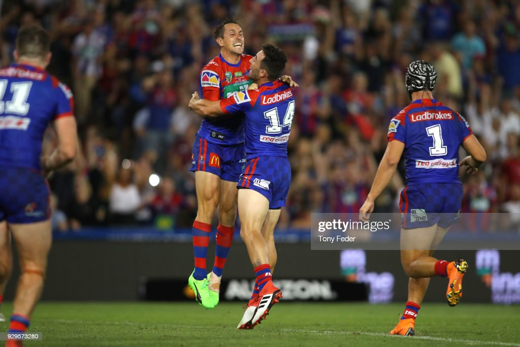 Mitchell Pearce of the Knights kicks a field goal in golden point and celebrates with team mate Brock Lamb during the round one NRL match between the Newcastle Knights and the Manly Sea Eagles at McDonald Jones Stadium on March 9, 2018 in Newcastle, Australia.