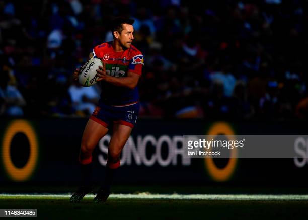 Mitchell Pearce of the Knights looks to pass the ball during the round nine NRL match between the Canterbury Bulldogs and the Newcastle Knights at...