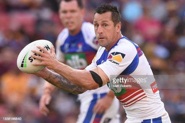 Mitchell Pearce of the Knights passes the ball during the round 25 NRL match between the Brisbane Broncos and the Newcastle Knights at Suncorp...