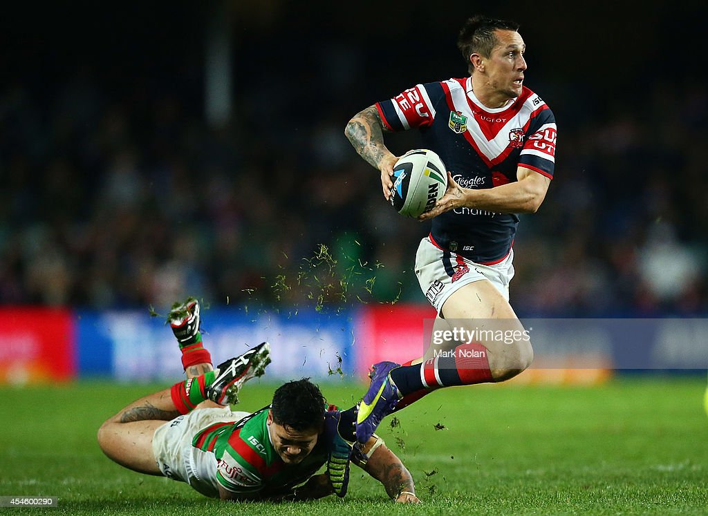 Mitchell Pearce of the Roosetrs jumps out of a tackle during the round 26 NRL match between the Sydney Roosters and the South Sydney Rabbitohs at Allianz Stadium on September 4, 2014 in Sydney, Australia.
