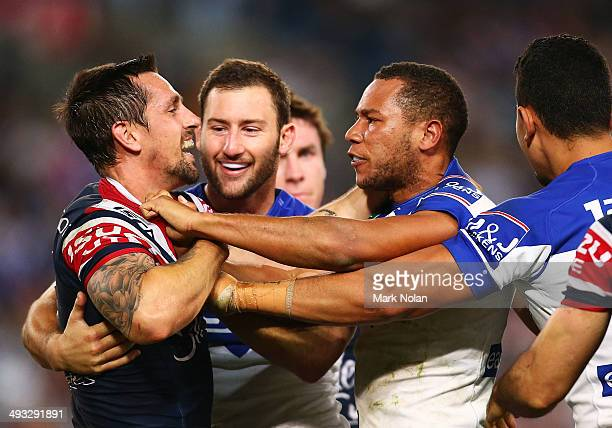 Mitchell Pearce of the Roosters and Moses Mbye of the Bulldogs face off in a scuffle during the round 11 NRL match between the CanterburyBankstown...