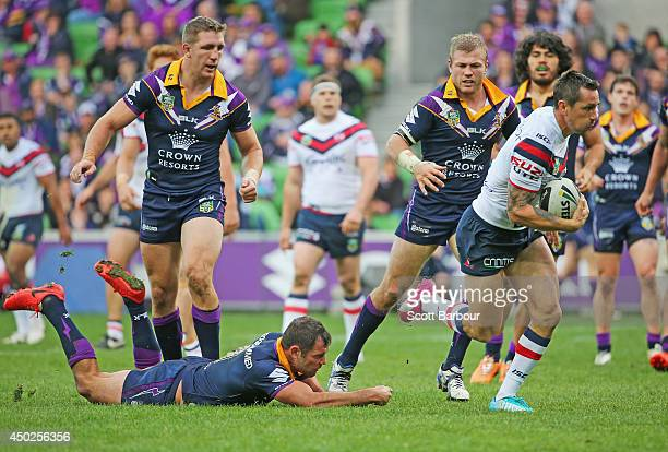 Mitchell Pearce of the Roosters beats the tackle of Cameron Smith of the Storm to score a try during the round 13 NRL match between the Melbourne...