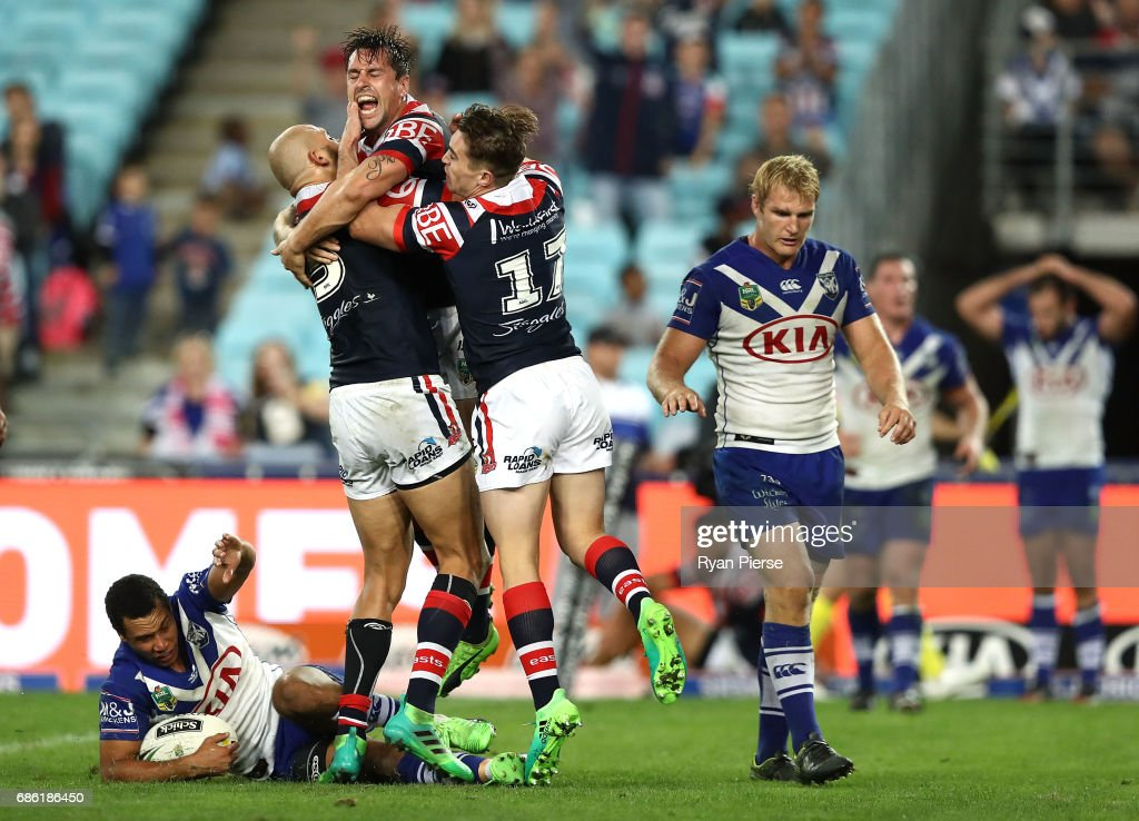 Mitchell Pearce of the Roosters celebrates after scoring the winning try during the round 11 NRL match between the Canterbury Bulldogs and the Sydney Roosters at ANZ Stadium on May 21, 2017 in Sydney, Australia.