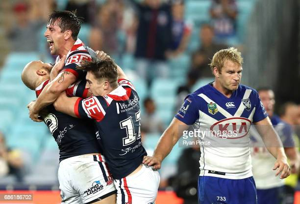 Mitchell Pearce of the Roosters celebrates after scoring the winning try during the round 11 NRL match between the Canterbury Bulldogs and the Sydney...