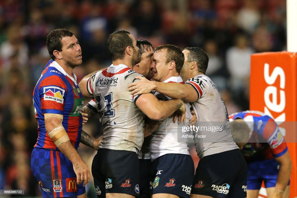 Mitchell Pearce of the Roosters celebrates his try with team mates during the round seven NRL match between the Newcastle Knights and the Sydney Roosters at McDonald Jones Stadium on April 14, 2017 in Newcastle, Australia.