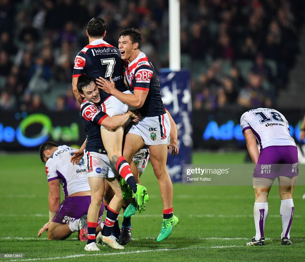 Mitchell Pearce of the Roosters celebrates with his team mates after kicking the winning goal during the round 16 NRL match between the Sydney Roosters and the Melbourne Storm at Adelaide Oval on June 24, 2017 in Adelaide, Australia.