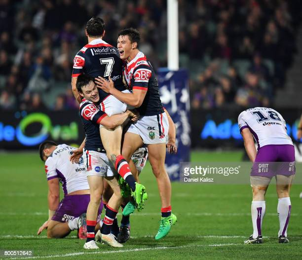 Mitchell Pearce of the Roosters celebrates with his team mates after kicking the winning goal during the round 16 NRL match between the Sydney...