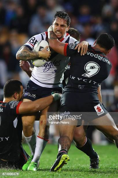 Mitchell Pearce of the Roosters charges forward during the round nine NRL match between the New Zealand Warriors and the Sydney Roosters at Mt Smart...