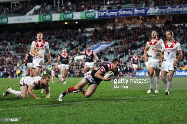 Mitchell Pearce of the Roosters dives over to score his third try during the round 22 NRL match between the Sydney Roosters and the St George...