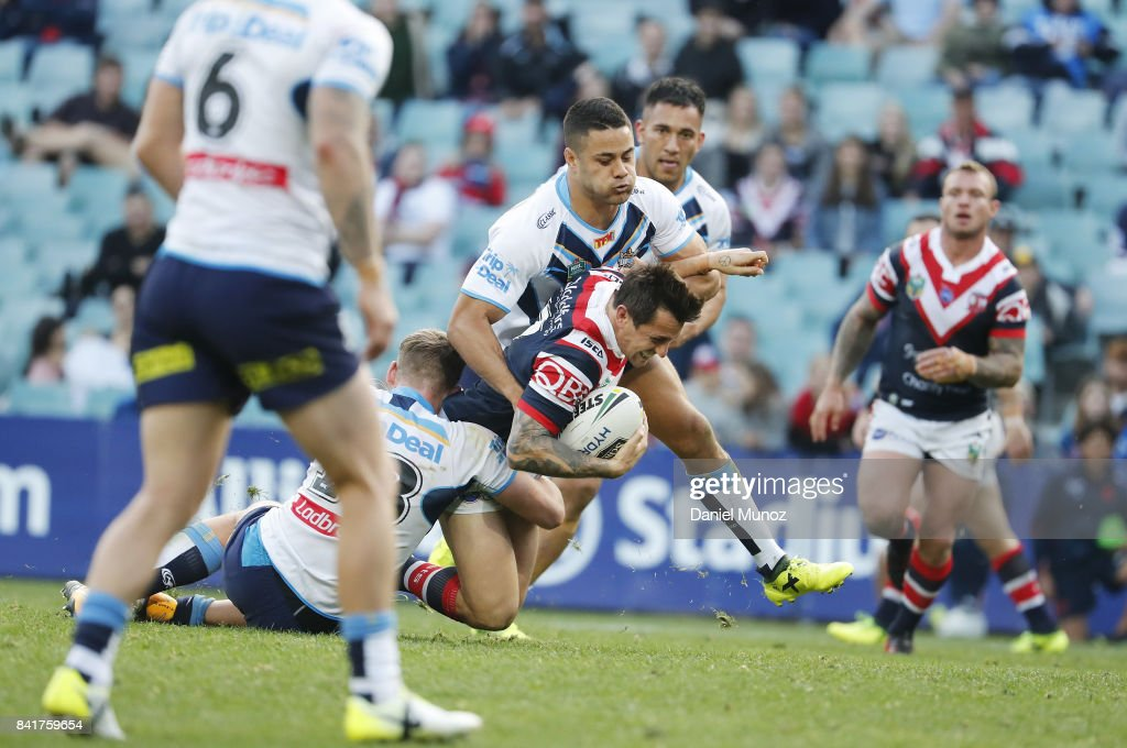 Mitchell Pearce of the Roosters is tackled by Jarryd Hayne of the Titans during the round 26 NRL match between the Sydney Roosters and the Gold Coast Titans at Allianz Stadium on September 2, 2017 in Sydney, Australia.