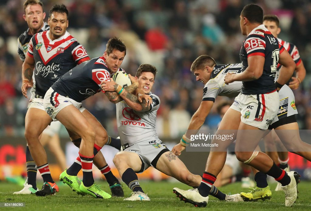 Mitchell Pearce of the Roosters is tackled during the round 21 NRL match between the Sydney Roosters and the North Queensland Cowboys at Allianz Stadium on July 29, 2017 in Sydney, Australia.
