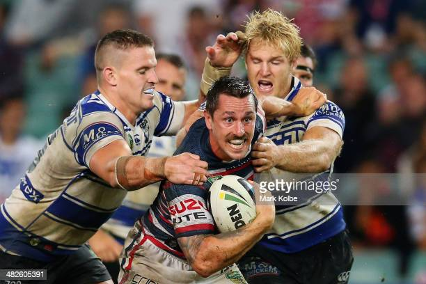 Mitchell Pearce of the Roosters is tackled during the round five NRL match between the Sydney Roosters and CanterburyBankstown Bulldogs at Allianz...