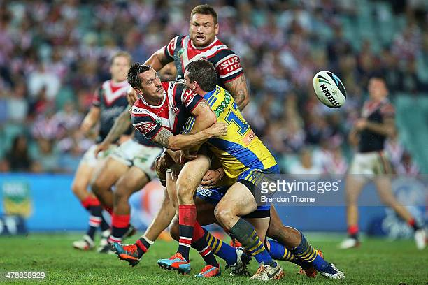 Mitchell Pearce of the Roosters offloads the ball to a team mate during the round two NRL match between the Sydney Roosters and the Parramatta Eels...