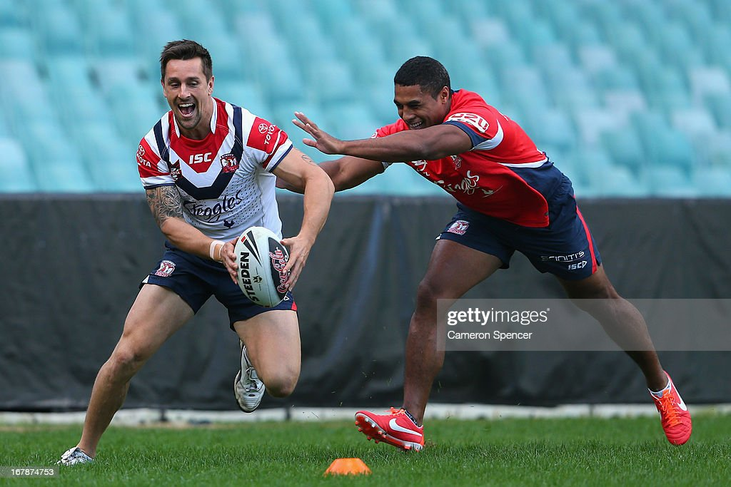 Mitchell Pearce of the Roosters runs the ball during a Sydney Roosters NRL training session at Allianz Stadium on May 2, 2013 in Sydney, Australia.