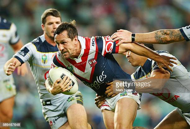 Mitchell Pearce of the Roosters runs the ball during the round 23 NRL match between the Sydney Roosters and the North Queensland Cowboys at Allianz...