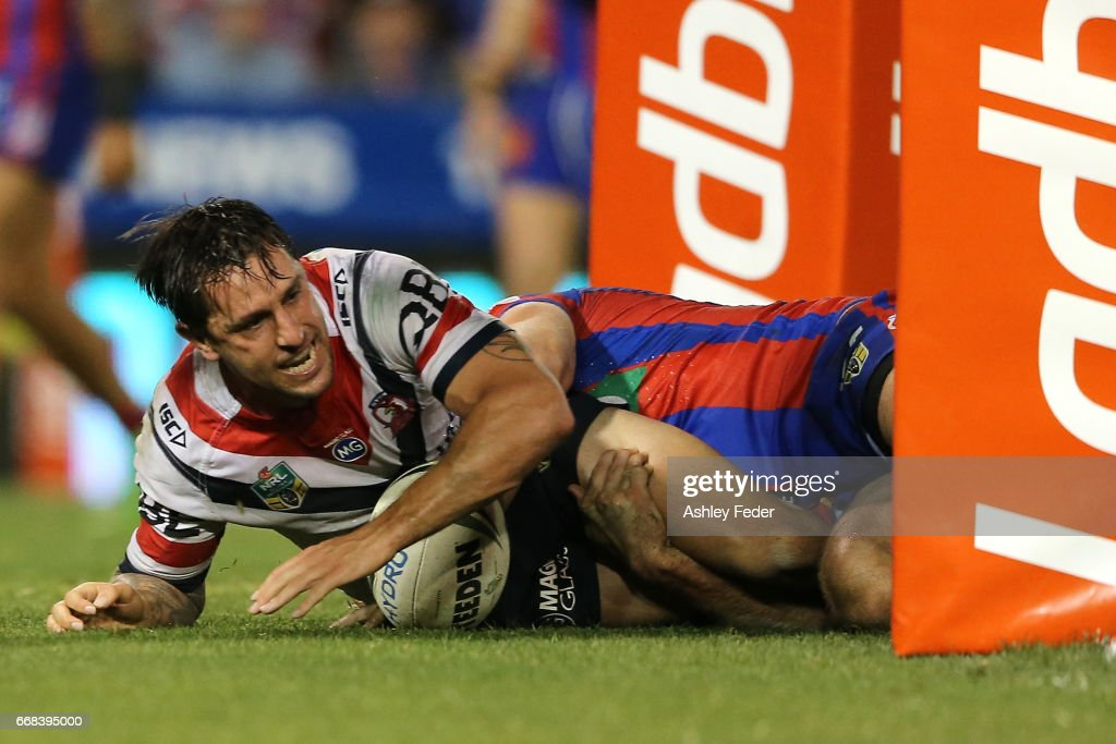 Mitchell Pearce of the Roosters scores a try during the round seven NRL match between the Newcastle Knights and the Sydney Roosters at McDonald Jones Stadium on April 14, 2017 in Newcastle, Australia.
