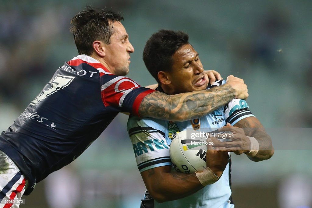 Mitchell Pearce of the Roosters tackles Ben Barba of the Sharks during the round 19 NRL match between the Sydney Roosters and the Cronulla Sharks at Allianz Stadium on July 18, 2016 in Sydney, Australia.