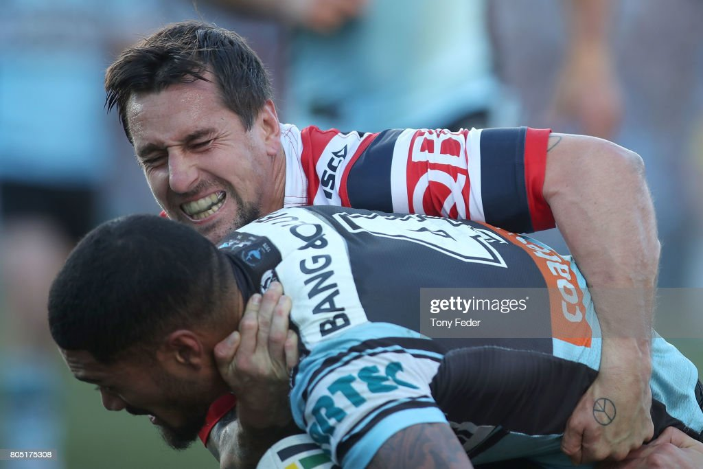 Mitchell Pearce of the Roosters tackles Ricky Leutele of the Sharks during the round 17 NRL match between the Sydney Roosters and the Cronulla Sharks at Central Coast Stadium on July 1, 2017 in Gosford, Australia.
