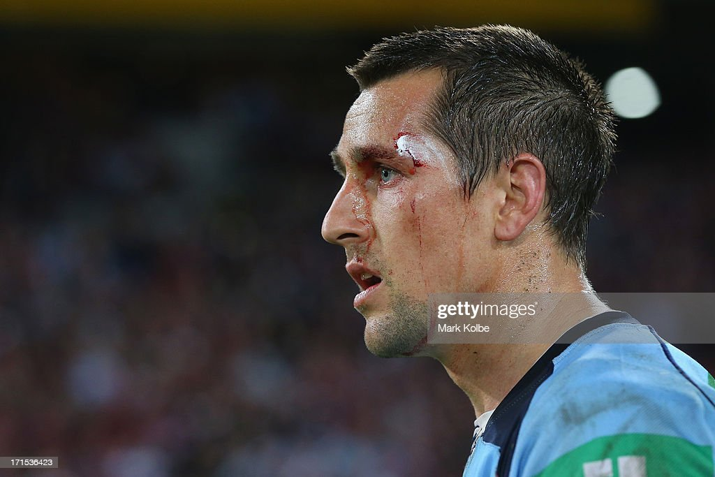 Mitchell Pearce of thre Blues looks dejected as he leaves the field after game two of the ARL State of Origin series between the Queensland Maroons and the New South Wales Blues at Suncorp Stadium on June 26, 2013 in Brisbane, Australia.