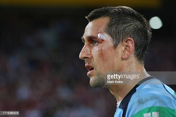 Mitchell Pearce of thre Blues looks dejected as he leaves the field after game two of the ARL State of Origin series between the Queensland Maroons...
