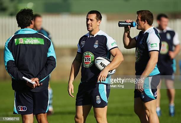 Mitchell Pearce talks to Blues coach Laurie Daley during a NSW Blues State of Origin training session at Coogee Oval on June 20 2013 in Sydney...
