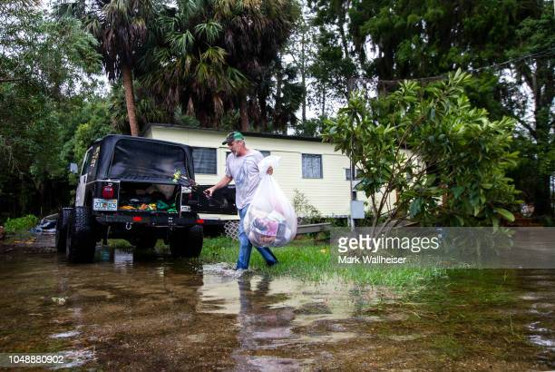 Mitchell Pope tries to salvage what he can from his mobile home as Hurricane Michael pushes the storm surge up the Wakulla and Saint Marks Rivers...