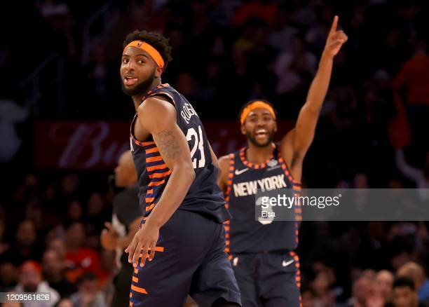 Mitchell Robinson amd Maurice Harkless of the New York Knicks celebrate in the fourth quarter against the Chicago Bulls at Madison Square Garden on...