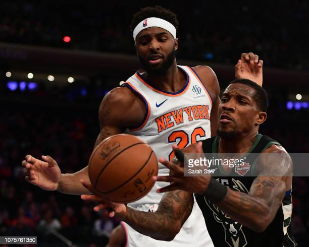 Mitchell Robinson of the New York Knicks and Eric Bledsoe of the Milwaukee Bucks reach for a loose ball during the fourth quarter of the game at...