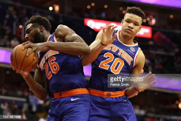 Mitchell Robinson of the New York Knicks and Kevin Knox of the New York Knicks grab a rebound against the Washington Wizards during the first half of...