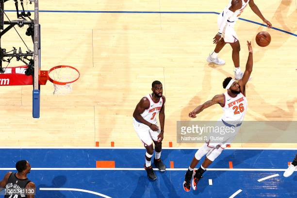 Mitchell Robinson of the New York Knicks blocks the shot against the Brooklyn Nets on October 29 2018 at Madison Square Garden in New York City New...