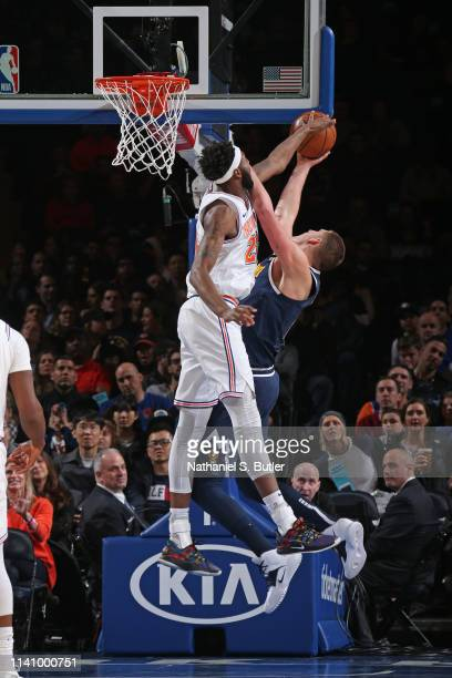 Mitchell Robinson of the New York Knicks blocks the shot of the Denver Nuggets on March 22 2019 at Madison Square Garden in New York City New York...