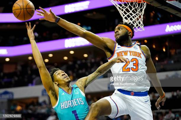 Mitchell Robinson of the New York Knicks defends against Malik Monk of the Charlotte Hornets during the third quarter at Spectrum Center on January...