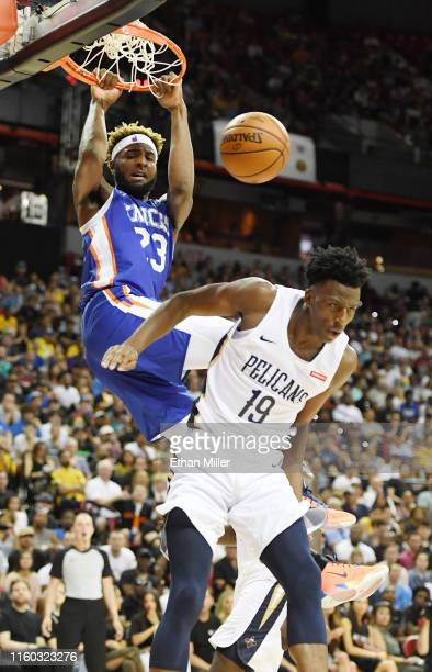 Mitchell Robinson of the New York Knicks dunks against Kavell BigbyWilliams of the New Orleans Pelicans during the 2019 NBA Summer League at the...
