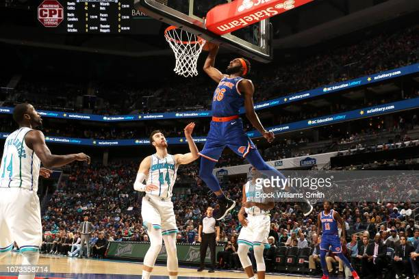 Mitchell Robinson of the New York Knicks dunks the ball against the Charlotte Hornets on December 14 2018 at Spectrum Center in Charlotte North...