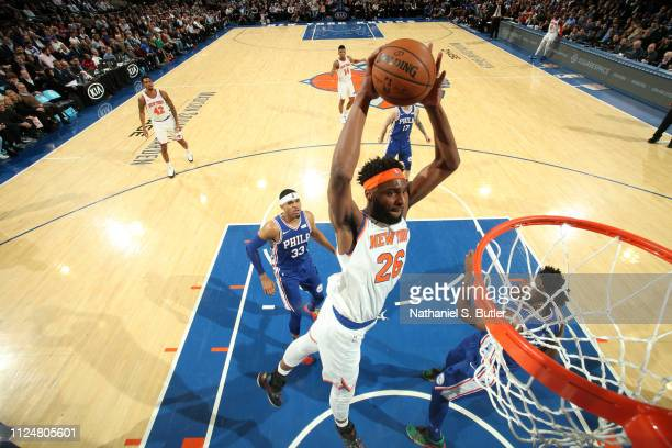 Mitchell Robinson of the New York Knicks dunks the ball against the Philadelphia 76ers on February 13 2019 at Madison Square Garden in New York City...