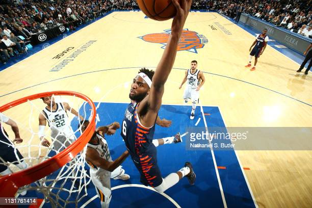 Mitchell Robinson of the New York Knicks dunks the ball against the Utah Jazz on March 20 2019 at Madison Square Garden in New York City New York...
