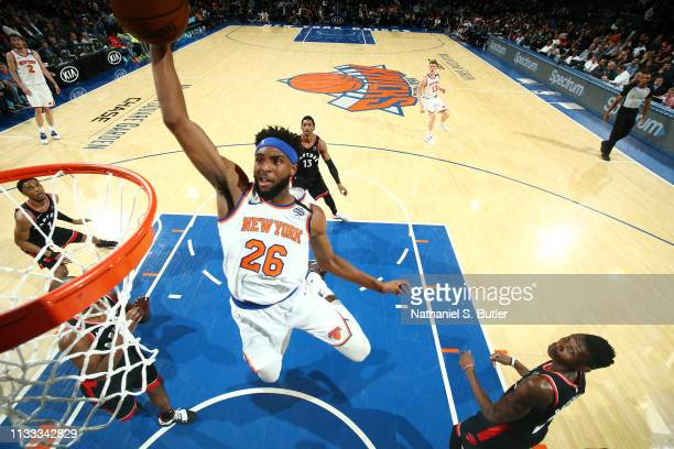 Mitchell Robinson of the New York Knicks dunks the ball against the Toronto Raptors on March 28 2019 at Madison Square Garden in New York City New...