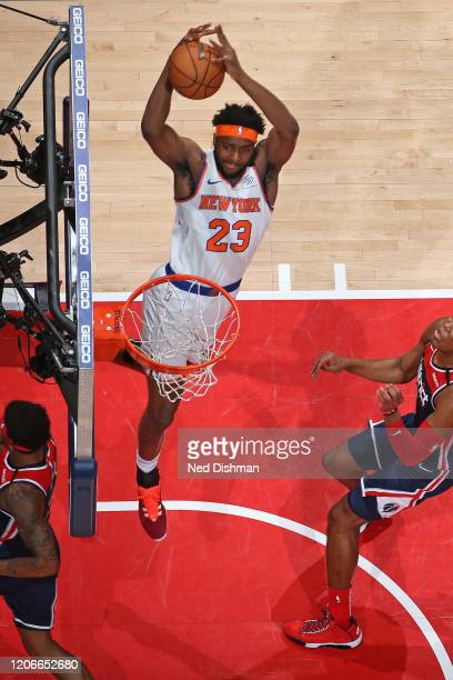 Mitchell Robinson of the New York Knicks dunks the ball against the Washington Wizards on March 10 2020 at Capital One Arena in Washington DC NOTE TO...