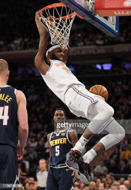 Mitchell Robinson of the New York Knicks makes a slam dunk during the second half of the game against the Denver Nuggets at Madison Square Garden on...