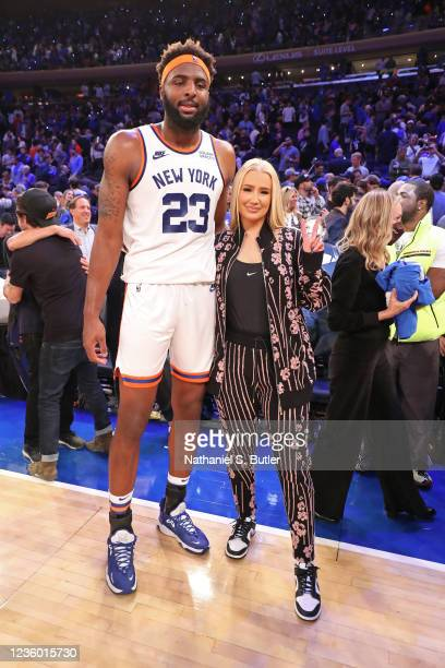 Mitchell Robinson of the New York Knicks poses for a photo with Rapper, Iggy Azalea after the game against the Boston Celtics on October 20, 2021 at...