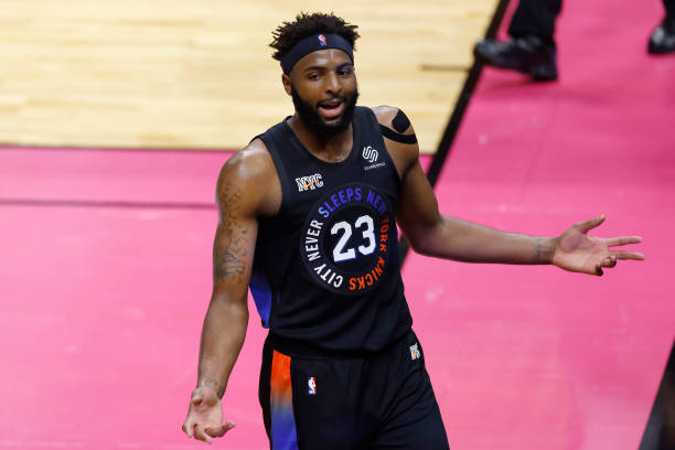 Mitchell Robinson of the New York Knicks reacts against the Miami Heat during the third quarter at American Airlines Arena on February 09, 2021 in...