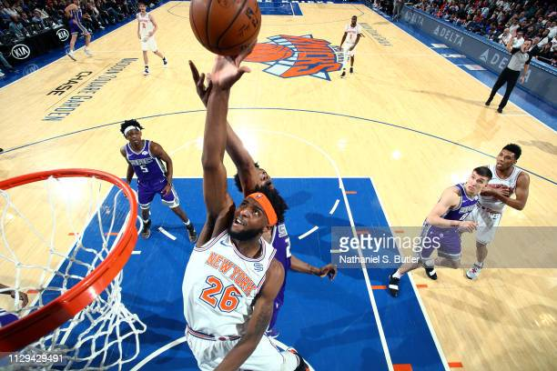 Mitchell Robinson of the New York Knicks rebounds the ball against the Sacramento Kings on March 9 2019 at Madison Square Garden in New York City New...