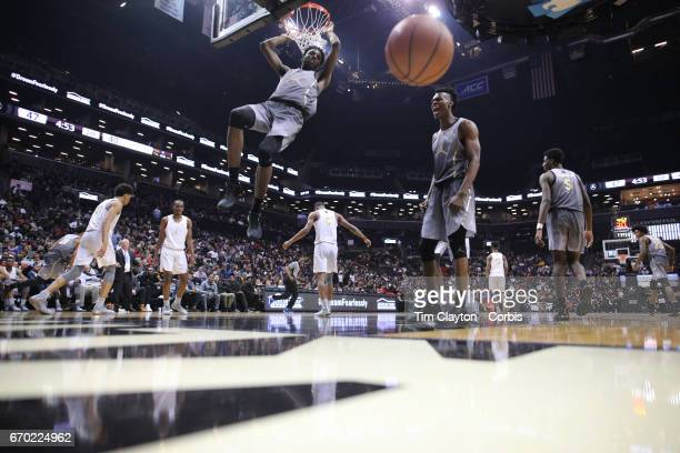 Mitchell Robinson W Kentucky dunks during the Jordan Brand Classic National Boys Team AllStar basketball game at The Barclays Center on April 14 2017...