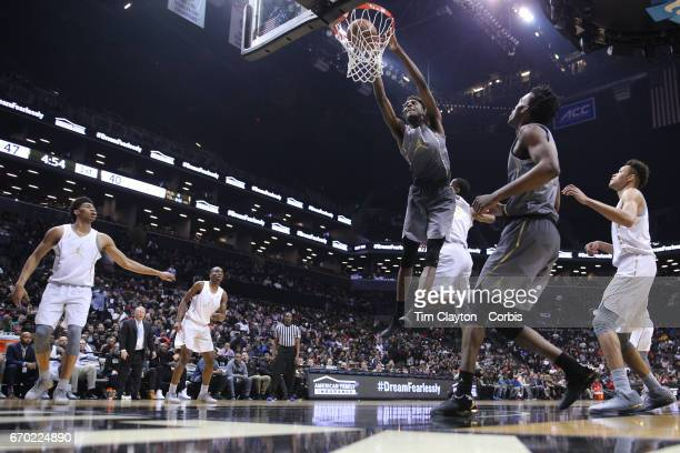 Mitchell Robinson W Kentucky dunks while defended by Billy Preston Kansas during the Jordan Brand Classic National Boys Team AllStar basketball game...