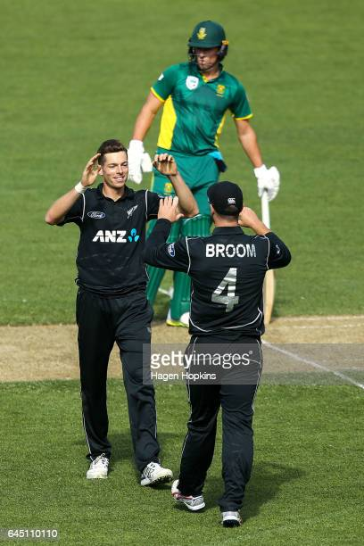 Mitchell Santner and Neil Broom of New Zealand celebrate after taking the wicket of David Miller of South Africa during game three of the One Day...