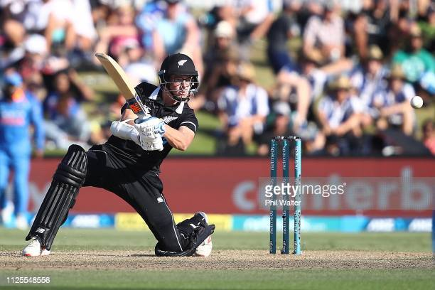 Mitchell Santner of New Zealand bats during game three of the One Day International series between New Zealand and India at Bay Oval on January 28...